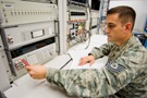 This U.S. Air Force photo by Abner Guzman shows Tech Sgt. Eric Rozzanno of the 62nd Maintenance Squadron calibrating a voltage standard.
