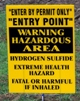 This photograph shows signage indicating the area may have hydrogen sulfide hazards.