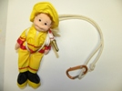 The doll pictured here was found in a dollar store, and all I did was tie some rope to simulate the harness and lanyard.