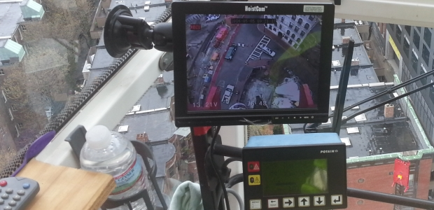 A monitor inside the cab of a tower crane provides the operator with close-up view of the load and lifting area. (Netarus, LLC photo)