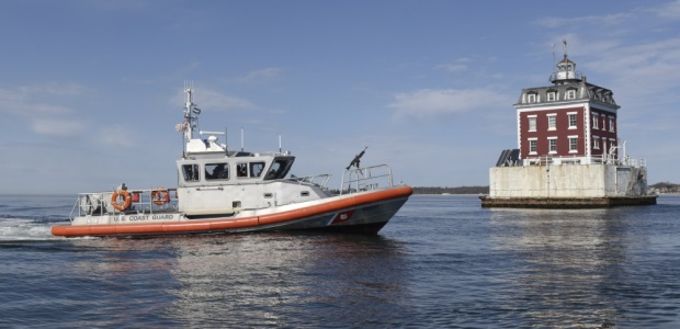 A 45-foot Response Boat - Medium from Coast Guard Station New London (Conn.) transits near the New London Ledge Light at the entrance to the Thames River on April 14, 2017. (U.S. Coast Guard photo by Petty Officer 3rd Class Steve Strohmaier)