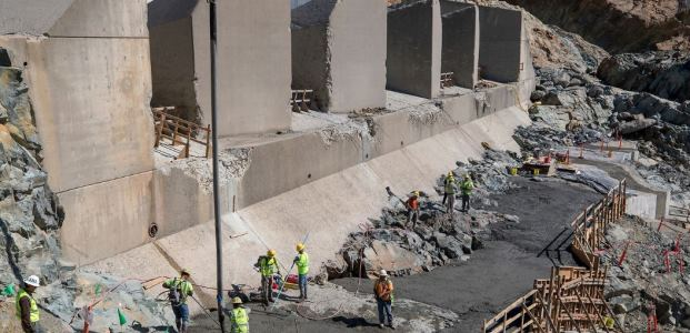 Kiewit Infrastructure workers placed leveling concrete for an access road below four energy dissipator blocks at the Oroville Dam