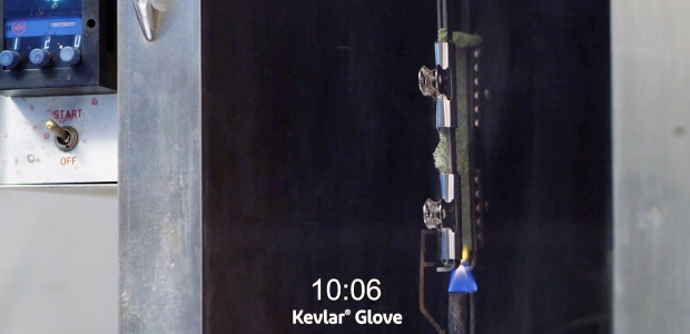 The vertical flame test shows a glove made of Kevlar not igniting or burning, while a glove made with HPPE ignites and continues to burn during a 12-second testing time. (DuPont Nomex photo)