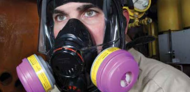 Because of the synergistic effect of many chemicals with noise, wearing a respirator and hearing protection together is an ideal defense against hearing loss whenever chemicals and noise are simultaneously present. (Honeywell Industrial Safety photo)
