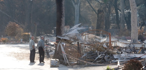 A wildfire damaged mobile homes and property in Fallbrook, Calif., in 2007. (Photo by Andrea Booher/FEMA)