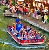 a tour boat on the San Antonio riverwalk, photo by Al Rendon/San Antonio Convention & Visitors Bureau