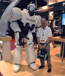 An image of OH&S Editor Jerry Laws next to a giant Pure Safety robot.