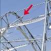 The arrow in this NIST image shows buckling of the steel frame of the Dallas Cowboys practice facility.