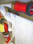 An image of an occupant use fire hose and a fire extinguisher.