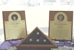 Plaques and an American flag honor FSIS Compliance Officers Jean Hillery and Thomas Quadros, killed in the line of duty June 21, 2000.
