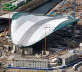 Taken April 1, 2010, this London 2012 photo shows work in progress to line the roof of the Aquatics Centre.