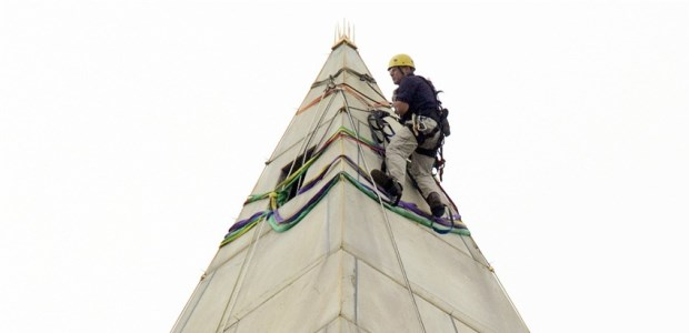 An engineer checked for damage done to the Washington Monument, a 555-foot obelisk located on the national mall in Washington, D.C., by a 5.8 magnitude earthquake on Aug. 23, 2011. The monument underwent repairs and was reopened May 12, 2014.