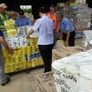 This photo from the Australian Government Disaster Relief site shows donated supplies being readied for flood victims.