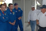 This photo (NASA/Jim Grossman) shows Hoggard, right, discussing emergency procedures with the crew of STS-129, commanded by Charles Hobaugh, left.
