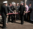 This NNSA photo shows Mike Thompson of NNSA and Nevada National Security Site Fire Chief Charles Fauerbach decoupling a fire hose to open the new Fire Station No. 1 in October 2010. Looking on are representatives from the Nevada congressional delegation and Nevada Site Office management.
