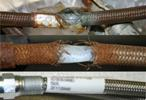 The hose that failed, shown at the top in this CSB photo, had been in service for seven months and was susceptible to corrosion from phosgene, according to the agency.