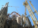 Modern tower cranes and workers wearing PPE are raising the Sagrada Familia spires ever higher.