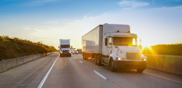 DOT clearly has jurisdiction over the truck on the highway, but OSHA regulations generally govern workers' safety and health and the responsibilities of employers to ensure their safety at the warehouse, the dock, and in all places trucker drivers go to deliver and pick up loads.
