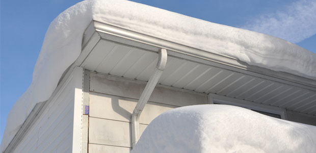 OSHA Reminds Workers and Employers to be Safe While Removing Snow from Rooftops