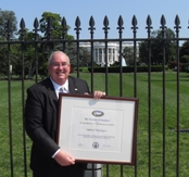 Carlos Lemos, president and CEO of Ambient Technologies, Inc., poses outside the White House with the Presidential