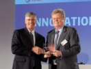 Alan Brown (left), health supervisor for Total Petrochemicals & Refining USA, Inc., received an innovation award from Michel Benezit of Total SA for improving safety while reducing costs. (Total Petrochemicals & Refining photo)