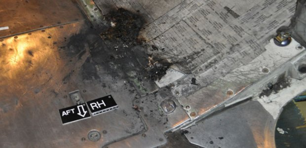 Fire damage to the lower aft cargo compartment of the Boeing 737-700 was contained to an area about 24 inches by 24 inches in size, according to the Transportation Safety Board of Canada
