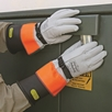 Rubber insulating gloves and leather protector gloves help keep workers safe any time they are exposed to energized parts. (Ansell Protective Products Inc. photo)