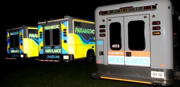 In this side-by-side photo, the newer ambulances on the left are much more visible than the older ambulance in Northumberland County EMS