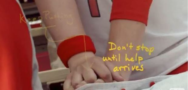 This image is a screen capture from an American Heart Association video promoting hands-only CPR.
