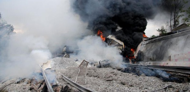 This photo showing rail cars containing terephthalic acid on fire after the May 28, 2013, grade crossing collision is included in the NTSB report and credited to the Maryland Department of the Environment.