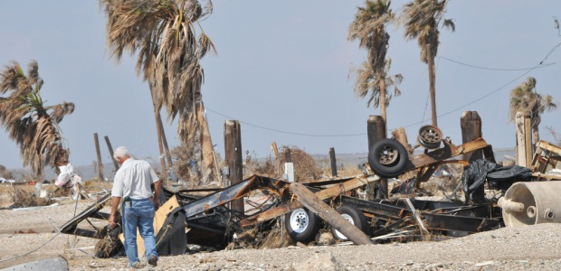 This photo taken by Patsy Lynch on Sept. 24, 2008, shows a resident of Gilchrist Island, Texas, looking at the remains of his home after Hurricane Ike devastated the area. Photo by Patsy Lynch/FEMA.