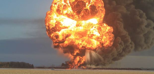 This photo showing the fireball resulting from the derailment of 21 cars from a BNSF crude oil train in Casselton, N.D., is included in the NTSB Hazardous Materials Group Factual Report. (Photo courtesy of Dawn Faught)
