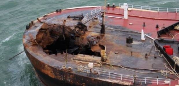 This U.S. Coast Guard photo included in the NTSB report shows damage to the port bow of barge B. No. 255 after the explosion.