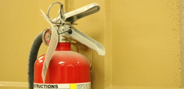 Most building codes require fire extinguishers; because they need to be checked monthly, most are fully charged and ready to use. However, whether or not employees should actually use them is sometimes a debate.