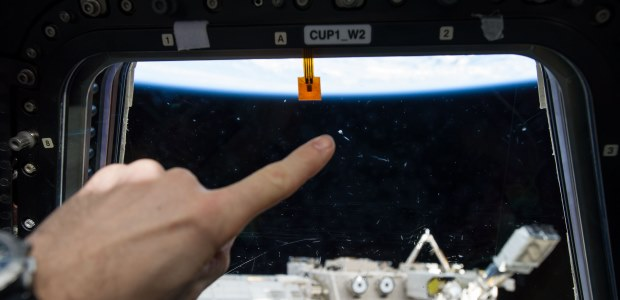 This NASA photo shows the mark left on a window of the International Space Station's Cupola by a micro meteor orbital debris strike. The Space Debris Sensor will measure the orbital debris environment for two to three years, according to NASA.