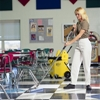 This adjustable mop handle features a double bend, padded grips, and a swivel top, reducing wrist strain and calluses, according to the manufacturer. (Kaivac Inc. photo)