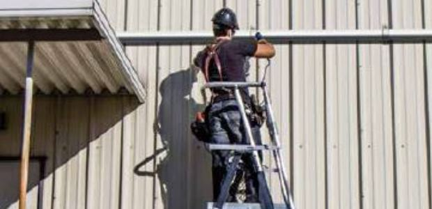 They are able to adjust to work on stairs or uneven surfaces and, unlike most lifts and scaffolds, aerial safety cages are constructed with nonconductive fiberglass rails, so they are approved for use around live electrical circuits. (Little Giant Ladder Systems photo)