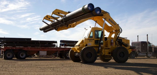 Typical loader lift arms tend to obstruct front visibility, while an overhead lift arm design provides full forward visibility when lifting, placing, and transporting loads. (Pettibone Heavy Equipment Group photo)