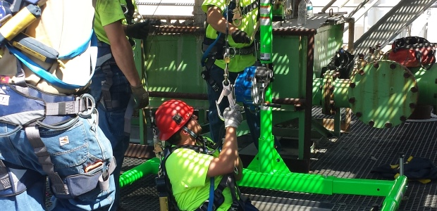 Davit arm systems and backup fall arrest systems make a vertical opening into a confined space safer during entry and exit. (Capital Safety photo)