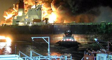 This photo shows the fire following the Houston Ship Channel accident. (Image from NTSB Marine Brief, courtesy of ITC City Dock security video)
