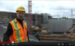 Managers and personnel working at the Kiewit Corp. Little Long Project in Ontario, Canada, discuss safety practices at the work site.